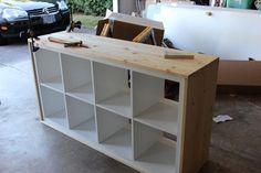 Unstained Wood-wrapped IKEA Kallax shelving unit