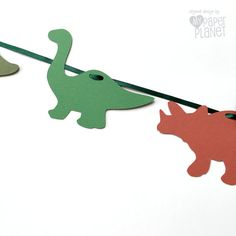 * Handmade in Australia *  Dinosaur garland made from textured cardstock in three colors. 21 dino shapes (in two designs) threaded onto a dark