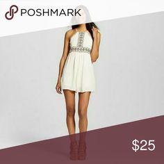 High Neck Embroidered Romper Romper features:  Pretty tribal Embroidery  Short legs are flowy almost looks like a dress High neck  Open shoulders Fully lined  Keyhole back with button closure 2 side pockets Xhilaration Pants Jumpsuits & Rompers