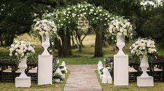 Wedding ceremony floral design by STEMS ATX DIY aisle decor  Wedding lanterns Aisle flowers  Moroccan lanterns