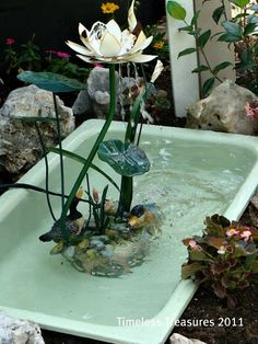 Cast iron sink repurposed into a garden pond.