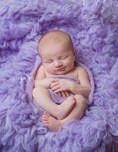 newborn photography, little baby smile love this flokati colour