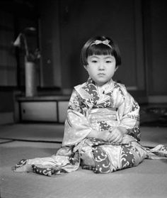 """""""A child wearing a typical Japanese Geisha kimono sits in seiza pose, circa 1950. (Photo by Evans/Three Lions)"""""""