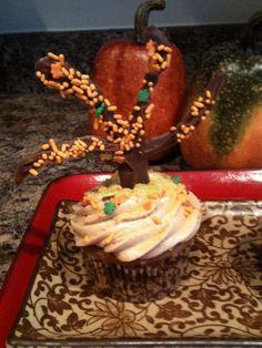 Spice cupcake with a dark chocolate tree