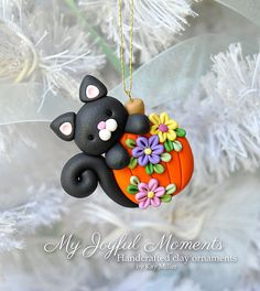 Handcrafted Polymer Clay Halloween Cat with Pumpkin Ornament by Kay Miller. Polymer Clay Halloween, Polymer Clay Ornaments, Sculpey Clay, Polymer Clay Christmas, Polymer Clay Figures, Cute Polymer Clay, Polymer Clay Projects, Polymer Clay Creations, Pumpkin Ornament