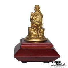 This Ginnie & Ginnie Exclusive Sai Baba with MDF base is a product from our Statue & Sculptures Collection. It is made of Brass and it got Brass finish on it. Its approx LxWxH is 2x1.5x3 inches. It is of approx 220 grams. Unique Code of this product is M400346.03