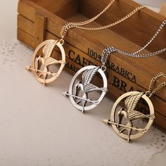 "Find More Pendant Necklaces Information about The Hunger Games Movie Necklace Single Chain ""M ocking Jay"" Antique Bronze Chain Arrow Bird Pendant Necklace for Women and Men,High Quality necklace shirt,China pendant lighting dining room Suppliers, Cheap pendant peridot from True Pretty Jewelry on Aliexpress.com"