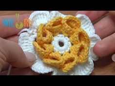 Technique for first loop. Watch how she makes her first loop--backwards off the finger twisting the yarn and swings it back around and starts crocheting. Folded Petal Crochet Flower Tutorial 22 - YouTube