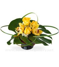modern orchid arrangement tropical leaf
