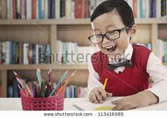 Asian student studying in a library by Creativa, via Shutterstock