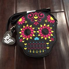 Skull Loungefly crossbody This is a colorful Loungefly skull crossbody that has bold color and is so cute!! This bag is a pretty good size to store most of your things. Super cute!!! Loungefly Bags Crossbody Bags