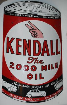Curved sign designed after a can of the company's product for Kendall The 2000 Mile Oil.