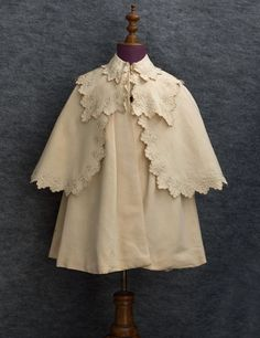 Child's embroidered silk coat with cape, c.1910.