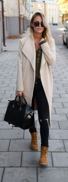 Kristin Sundberg rocks the Timberland trend, looking uber cool in a white coat and black skinny jeans.