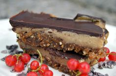 Quick and easy chocolate caramel slice, AKA millionaire's shortbread. It's dairy and gluten freewith a fruit and nut base, a cashew caramel middle.