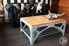 """The Harbour Bridge Coffee Table  Inspired by the portal bracing on the Sydney Harbour Bridge. Featuring 148 genuine hot rivets forged eyebar magazine rack and 2.5"""" solid oak plank top."""