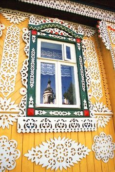 Russian wooden house. Window and carved decorations.