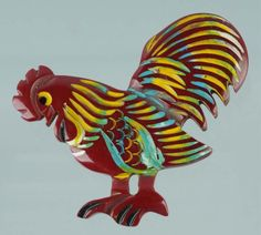 A cute vintage Bakelite red rooster pin. #vintage #jewelry #brooches