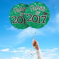"""Includes 2 Green 17"""" round Class of 2017 graduation foil balloons. """"Class of 2017"""" is printed on both sides of the balloons. Use balloons for your graduation party centerpieces or balloon bouquets."""