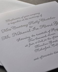 Gray letterpressed hand-written calligraphy on heavy white paper stock createedthis simply elegant A Day in May Designslook.