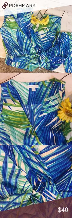 """{NEW YORK & COMPANY} Palm Tropical Romper Gorgeous tropical blue and green palm romper by New York & Company.  Ties at waist .  Pockets .  Tapered Leg .  Faux wrap style .  EUC.  All measurements taken flat .  Size 0 measures shoulder to hem 58"""", armpit to armpit 15"""", waist 14"""".  A66 New York & Company Pants Jumpsuits & Rompers"""