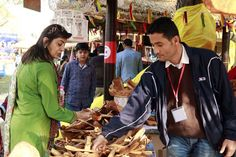 Visitors buying olive wood utility items from Tunisia from Surajkund Mela! Stalls, Wood, Woodwind Instrument, Timber Wood, Trees