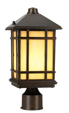 """J du J 14"""" High Mission Hills Outdoor Post Light by Kathy Ireland. $89.99. Give your home a classic look of Americana styling with this wall light from the J du J line by Kathy Ireland Home. The piece comes in a rubbed bronze finish with honey Tiffany-style glass panels. A grid overlay on the glass gives the design a classic Mission, Arts and Crafts style look. Post mount light style. Pole not included.. Save 33%!"""