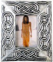 "CELTIC PHOTO FRAME BASED ON KNOTS. MEASURES: 15 x 20 cm. photo (6"" x 8"" aprox.).  Embossed (repousse) photo frames and frames in general. Most common size is 15 x 20 cm. photo (6"" x 8"" aprox.). Great variety of motifs and designs based in historical ornaments from all ages and own designs. Like in all my works you can choose all the parts of the embossing design, including main motif, names, dedications, date… and all you want to include."