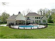 View from the backyard of the fenced off pool area | 1314 Log Cabin Lane, Ladue, MO 63124
