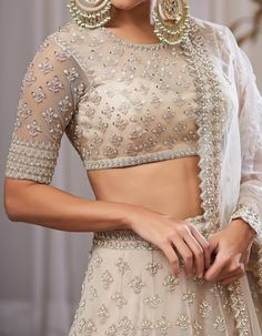 Check out our Ivory Organza Cutdana Work Lehenga Set by ANUSHREE REDDY available at Ogaan Online store at special price. Anushree Reddy's elaborate festive pieces with intricate zardosi and gota details in raw silks are a bridal favourite at Ogaan Indian Fashion Dresses, Indian Bridal Outfits, Indian Gowns Dresses, Dress Indian Style, Indian Designer Outfits, Bridal Dresses, Indian Wedding Gowns, Fashion Blouses, Indian Blouse
