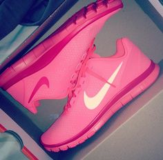Strawberry pink nike shoes.