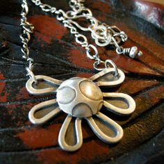 Sterling silver flower sun necklace by coldfeetjewelry on Etsy,