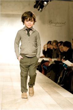 This little runway model is looking sophisticated with his shirt, tie and sweater combination. Love!