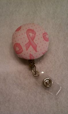 Breast cancer awearness id badge reel. $6.00, via Etsy.