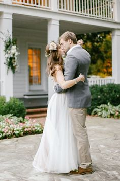 a kiss on the front lawn |#cedarwoodweddings