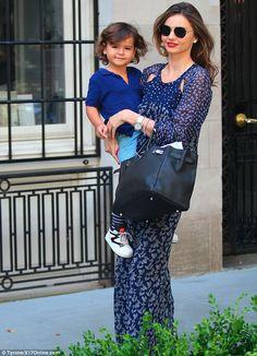 July 5, 2014: Model mommy: Miranda Kerr looks elegant as she carries toddler Flynn in her arms outside h...