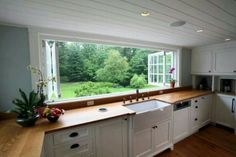 Kitchen serving window. Put a bar & stools on other side so you can quickly & easily eat outside / serve a buffet.