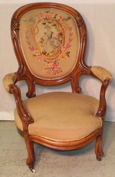 Victorian walnut gents chair with needlepoint back.