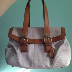 Light purple coach shoulder bag Adorable super light purple shoulder bag. Has feet on the bottom, 1 zip pocket inside, and 2 open pockets. Great bag! I'm moving to a diaper size bag these days, so sadly, this one must go. Has a couple of stains but nothing horrible, price reflects wear. Coach Bags Shoulder Bags