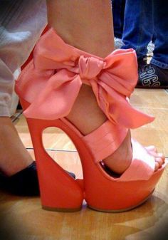 Amazing orange platform heels with salmon silk straps and bow.