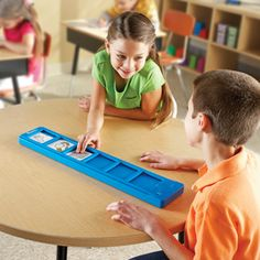 Talk Bar™ by Learning Resources--Slide in up to 6 cards and record a 10-second audio message for each.