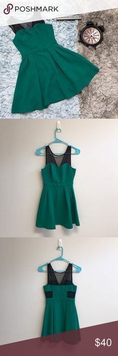 BCBGeneration Emerald Green Dress Only worn once could be mistaken for brand new! It is super cute and perfect for the upcoming spring and summer! The bust is approximately 29 inches around and the length is approximately 30 inches. There are mesh cutouts on the dress on the backside as shown in the picture above, they have no damage to them. Feel free to offer or bundle BCBGeneration Dresses