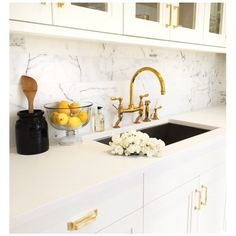 Beautiful bold + brass kitchen design by Kapito Muller Interiors including Mission hardware by Rejuvenation.