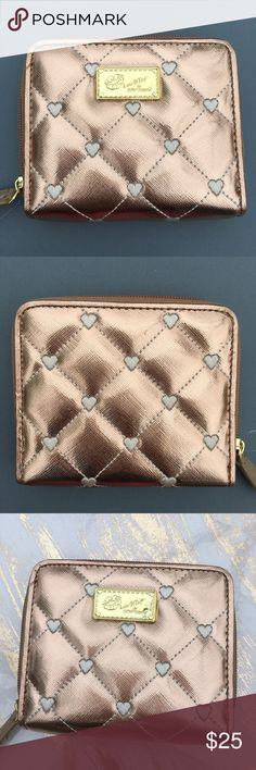 """Betsey Johnson mini wallet Rose Gold zip around Betsey Johnson mini zip around wallet ✨ Rose Gold ✨ faux leather saffiano finish quilted hearts ✨ 4x5x1"""" holds at least three credit cards + , inside zippered pocket, ID slot space for cash, tan faux leather lining ✨ brand new & super hot ! Betsey Johnson Bags Wallets"""