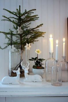 Candles and porcelain deer.
