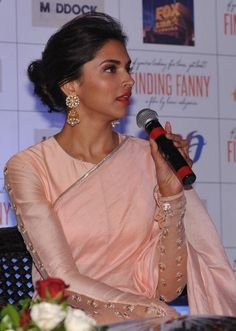 "Deepika Padukone in Pink Saree with Full Sleeve Blouse and Round Neck Designs New Images 2014 Elegant and exotic Bollywood Actress Deepika Padukone in Pink Saree at the promotional event of film ""Finding Fanny"". In the year Fanny Movie was th Netted Blouse Designs, Blouse Back Neck Designs, Latest Saree Blouse Designs, Saris, Sari Bluse, Peach Saree, Net Blouses, Stylish Blouse Design, Gowns"