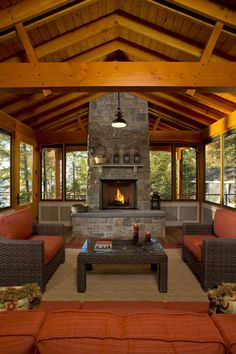 Wilcox Furniture for a Rustic Porch with a Orange Cushions and Bolton Landing Modern Cabin by Teakwood Builders, Inc. Porch Fireplace, Outdoor Fireplace Designs, Backyard Fireplace, Fireplace Hearth, Outdoor Fireplaces, Backyard Pavilion, Backyard Gazebo, Backyard Pool Designs, Backyard Lighting