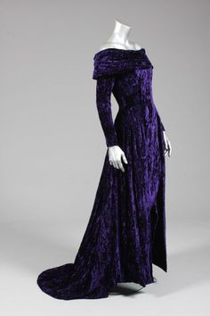Bruce Oldfield Purple velvet evening gown, similar to the one worn by Princess Diana during an official visit to Portugal in 1987, labelled, with broad collar framing the shoulders, with narrow tapering skirt and draped, trained overskirt to the sides