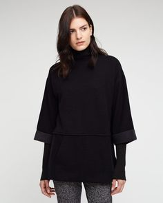 Easy round-neck sweatshirt crafted in a soft cotton-blend. Kanga pocket, wide three-quarter length sleeves, side-slit hem and relaxed fit for a casual silhouette. Channel sports luxe in this piece.