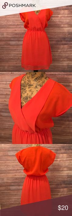 H&M Dress V-neck dress H&M V-neck flowy dress in vibrant orange color. Size 4. Excellent condition. No flaws! H&M Dresses